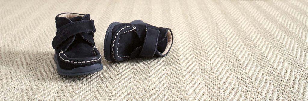 black shoe on a white carpet